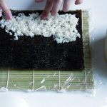 Cover whole nori with sushi rice