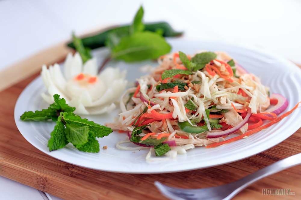 Shred cabbage and onion in Vietnamese chicken salad