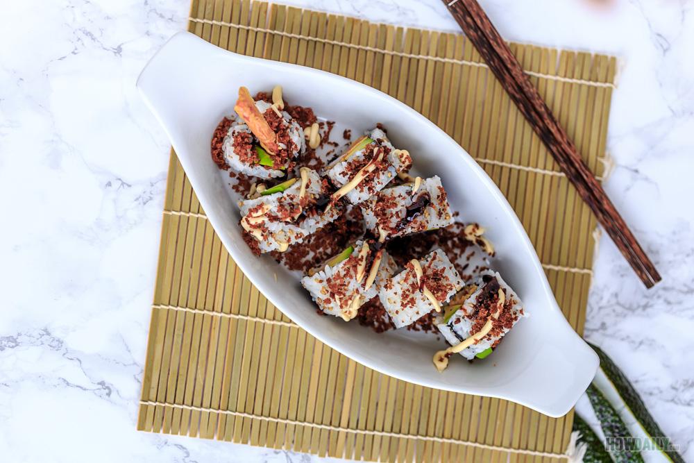 Top kewpie mayo and unagi sauce on shrimp tempura rolls