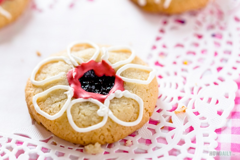 Thumbprint cookie with flower decoration