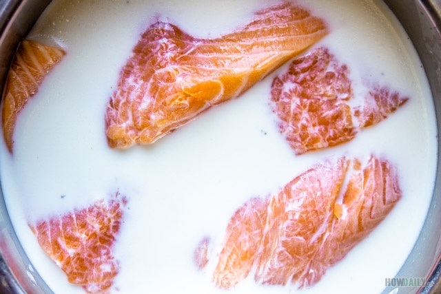 Soak salmon with whole milk and salt